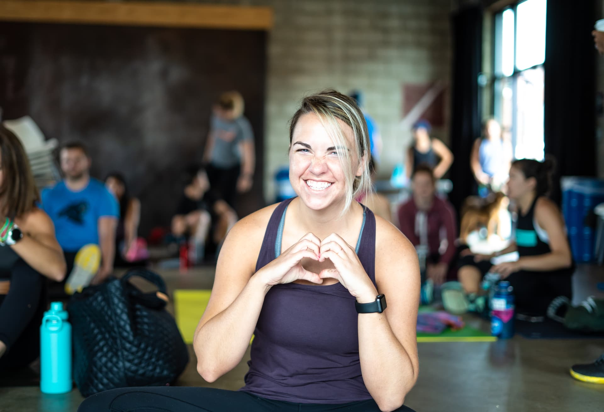 Girl heart with hands doing yoga in charlotte
