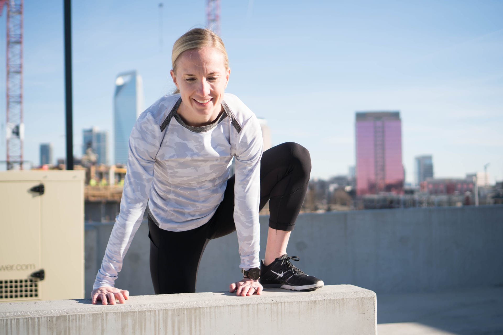 Fitness instructor with Charlotte skyline in background